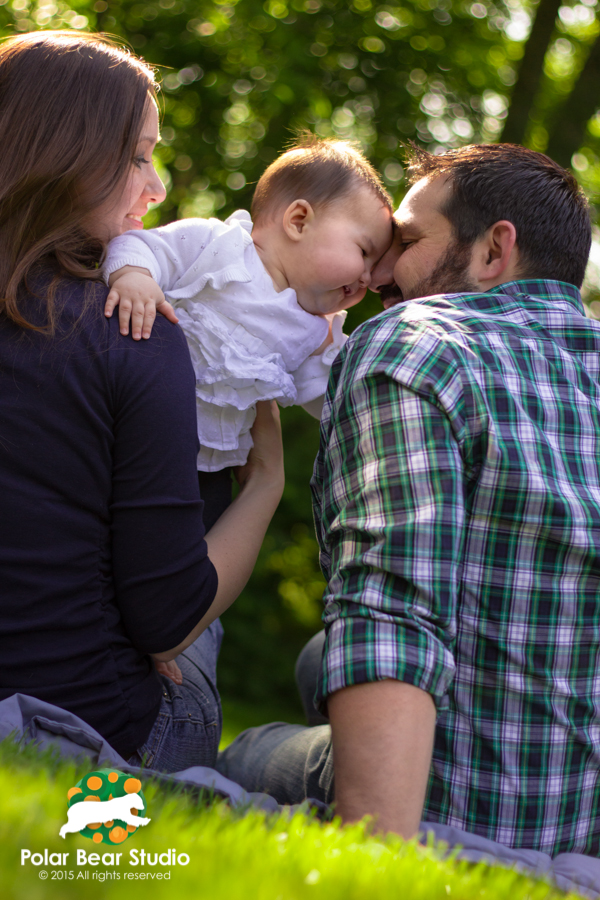 nuzzling dad, bokeh background family photo | Photo by Polar Bear Studio, Copyright 2015